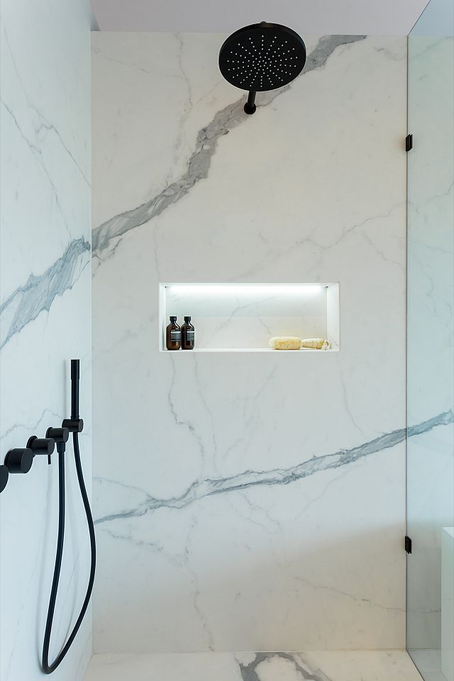 Statuario Matt. Zahra Apartments by Spyre Group_03 showers.jpg